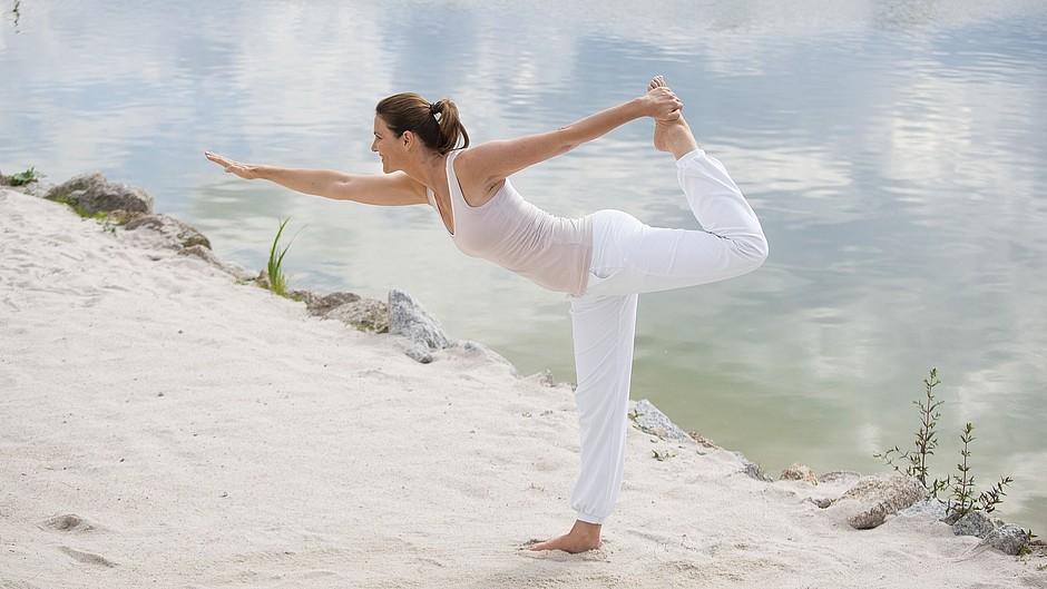Woman yoga beach sea body